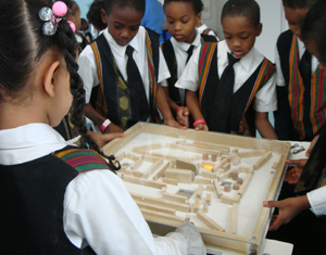 A school group helps playtest the cooperative water droplet maze at the Children's Museum of Pittsburgh